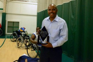 Coach Jackson with the Norco Rolling Devils Wheelchair Basketball Tournament 2014 Championship Trophy